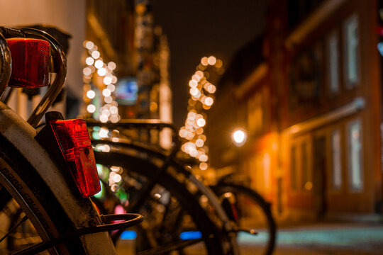Old bike in the city of Münster Westfalen in Germany at night