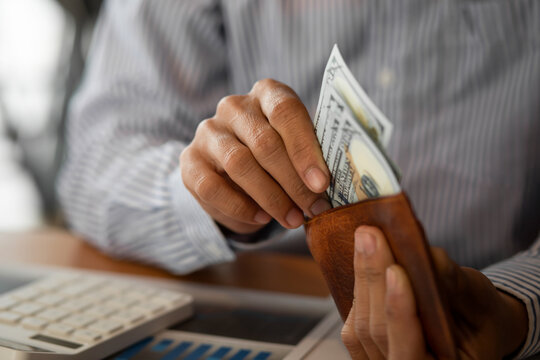 Close-up Business Hands money pocket and counting money American dollars , Income and Business concept.