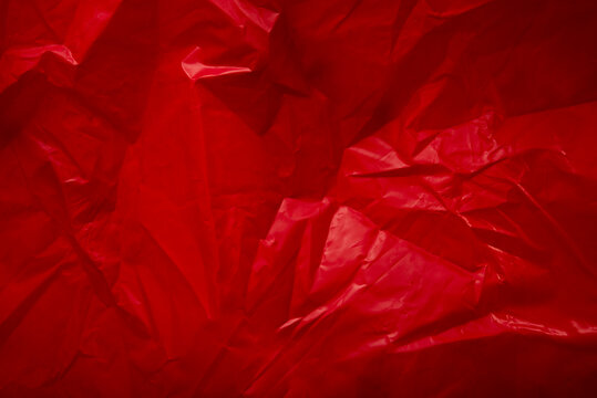 Crumpled rustic red paper making a perfect wallpaper bg