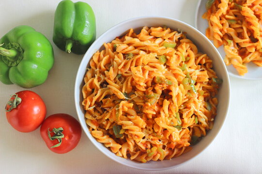 Red sauce pasta with bell peppers. Homemade Fusilli Pasta with Arrabbiata sauce