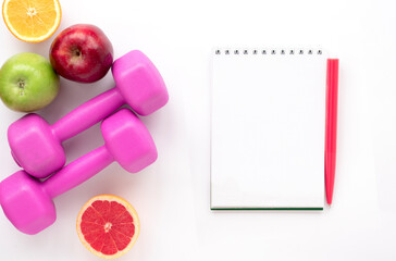 Diet plan. Motivation for a new trend of healthy and sporty life. Flat lay on kettlebell with fresh fruits
