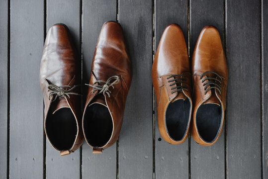 Close-up Of Shoes On Wooden Planks