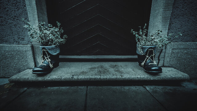 Boots on the doorstep of the house, horror