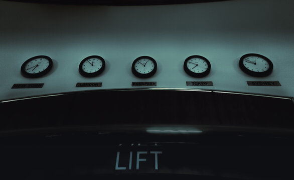 Clock with time in different countries, hotel lobby, horror