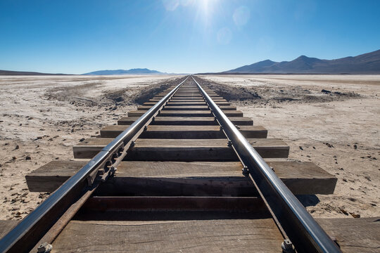 Railway tracks leading to Andes Mountains in the Atacama desert, Bolivia