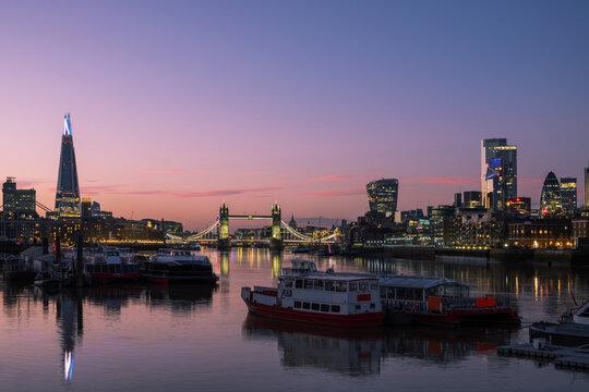 City skyline and Tower Bridge at night, London, England, UK