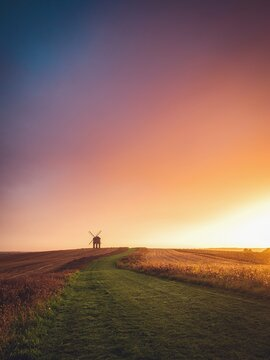 Traditional windmill in rural landscape at sunrise, Warwickshire, England, UK