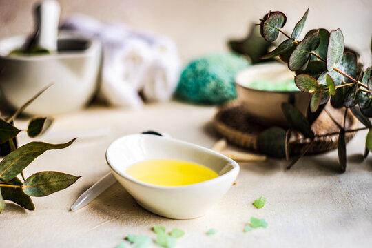 Bath salts, oil, fresh eucalyptus, sponge and towel wellbeing arrangement