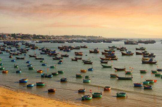 Traditional fishing boats anchored by the beach, Phat Thiet, Mui Ne, Vietnam