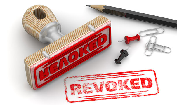 Revoked. The stamp and an imprint. Wooden stamp and red imprint REVOKED on white surface. 3D illustration