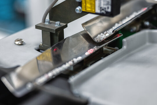Automatic sorting of diamonds, modern machine vision technologies. Diamonds move along an angular metal tray