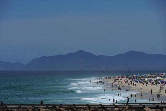 Barra da tijuca beach on a sunny day, with the fishermen's pier