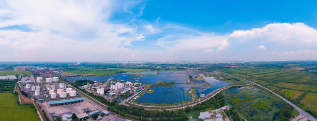 Panorama Aerial view, Solar plant rows array of ground mount system Installation. Crude oil tanker...