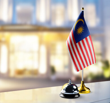 Malaysia flag on the reception desk in the lobby of the hotel