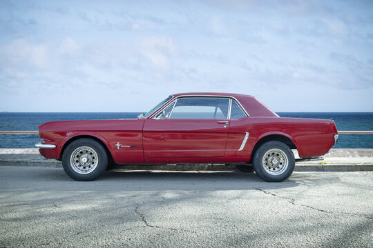 BARCELONA, SPAIN-FEBRUARY 2, 2021: 1965 Ford Mustang GT Hardtop (first generation) next to sea