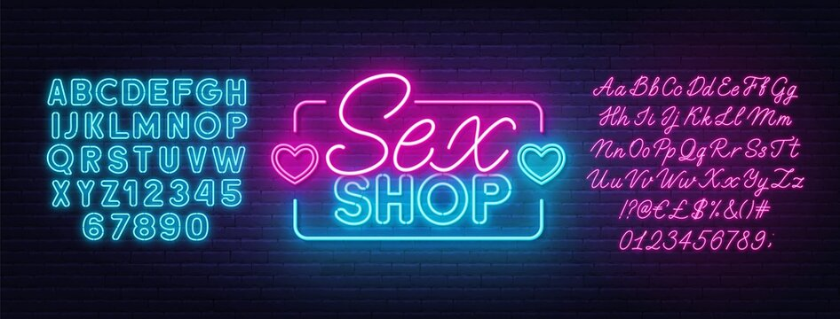 Sex Shop neon sign on brick wall background. Pink and blue neon alphabets.
