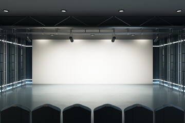 Fototapeta Home cinema concept with big blank white screen with projectors on top, raw of seats, gloosy floor and led lights on the walls. Mockup. 3D rendering. obraz