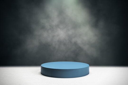 Blank blue cylinder form on concrete top and smoky dark background. Mockup. 3D rendering
