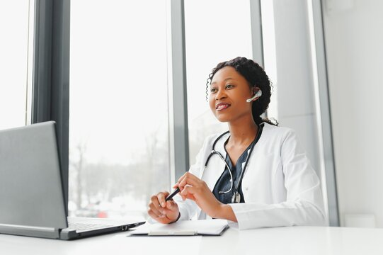 Telehealth, African American doctor in headset consulting with the patient over the phone call. Health care call center and telehealth online concept
