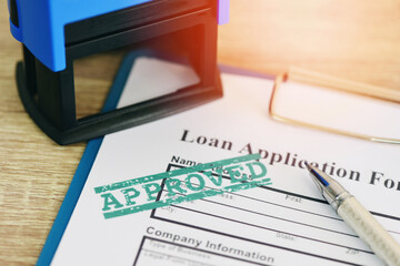 Fototapeta Loan approval, Loan application form with Rubber stamping that says Loan Approved, Financial loan money contract agreement company credit or person.
