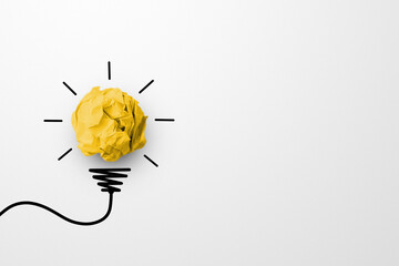 Obraz Creative thinking ideas and innovation concept. Paper scrap ball yellow colour with light bulb symbol on white background - fototapety do salonu