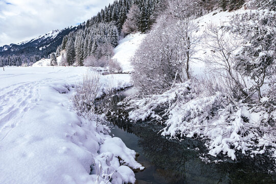 wintry river in the alps