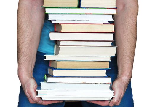 It is a stack of books in a man's hands, isolated on a white background. The concept of education and the study of sciences.