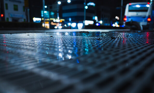 Abstract night background with shiny wet street