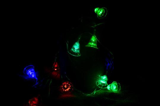 Multicolored bright lanterns on a dark background
