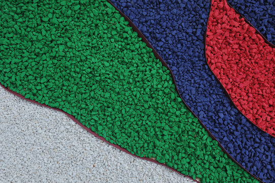Garden decoration with painted gravel of different colors, landscaping with backfill