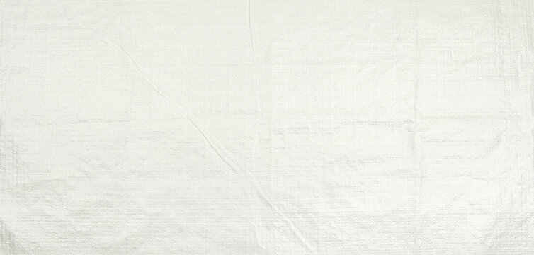 White woven plastic bag texture background.  Polypropylene sack cloth surface.