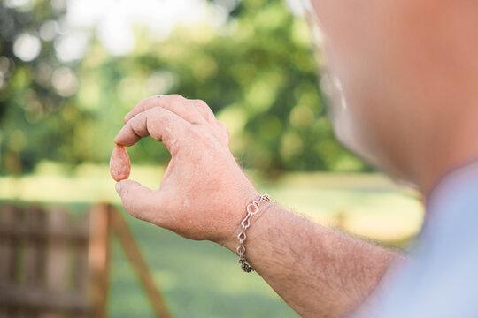 Man Holding a Gemstone