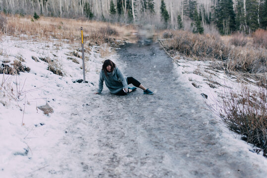 A woman falling on ice