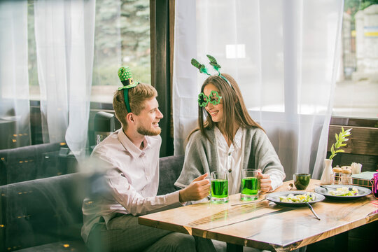 a couple young people celebrate St. Patrick's Day
