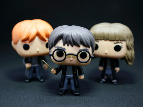 Harry Potter, Hermione Granger and Ron Weasley Funko pop. Isolated black. Dark.