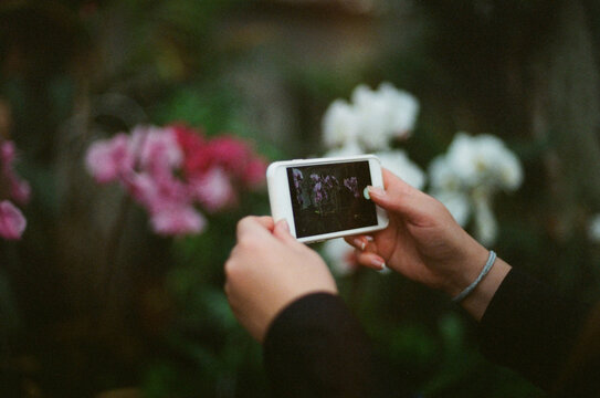 A taking photo with a mobile phone