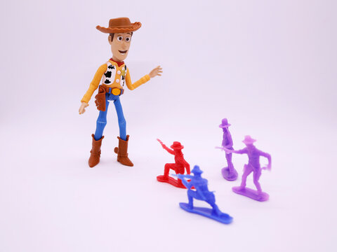 Toy story movie. Woody. Pixar and Disney movie toys. Cowboy. Woody playing with  toy cowboys. Isolated white.