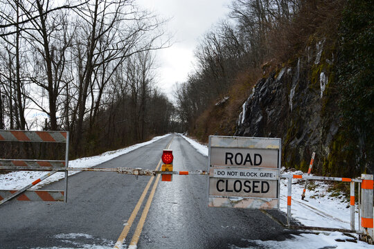 Barricades stop traffic and announce a section of the Blue Ridge Parkway near Asheville NC is closed for the winter.