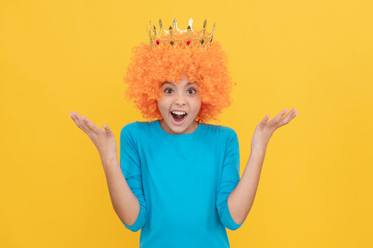 surprised selfish child girl in curly wig and princess diadem, surprise
