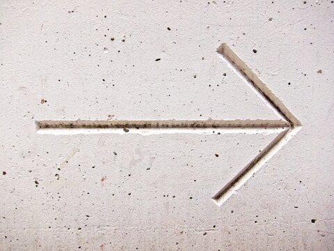 Directional arrow in concrete