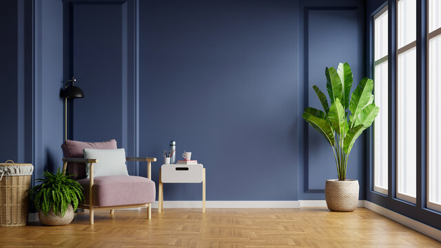 Interior of light room with armchair on empty dark blue wall background.