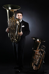 Tuba player brass instrument. Classical musician portrait