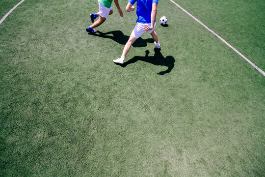 Two soccer players playing in a soccer field during a match