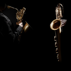 Jazz saxophone players. Saxophonist hands playing baritone sax