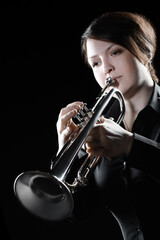 Trumpet player. Woman playing jazz trumpet