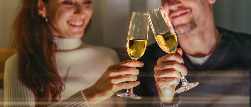 couple with glass of wine for anniversary celebration