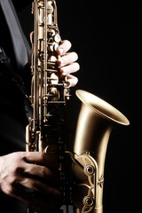 Saxophone player hands. Saxophonist