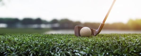 Fototapeta playing golf on a beautiful field