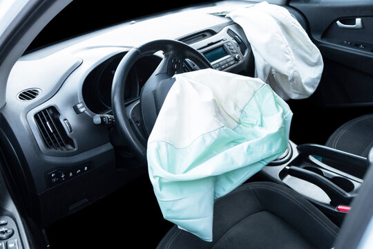 Airbag exploded at a car after the accident. Driver and Passenger AirBag. Car crash. Interior of a car after crash. Inside Automobile