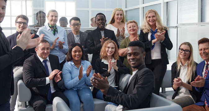 international team of young business people applauding together .